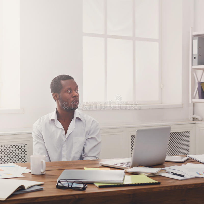 Thoughtful young black man enjoying his successful business stock images