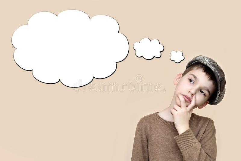 Thoughtful young boy with an empty thought bubble. Thoughtful young boy wearing cap with an empty thought bubble. Vintage style stock image