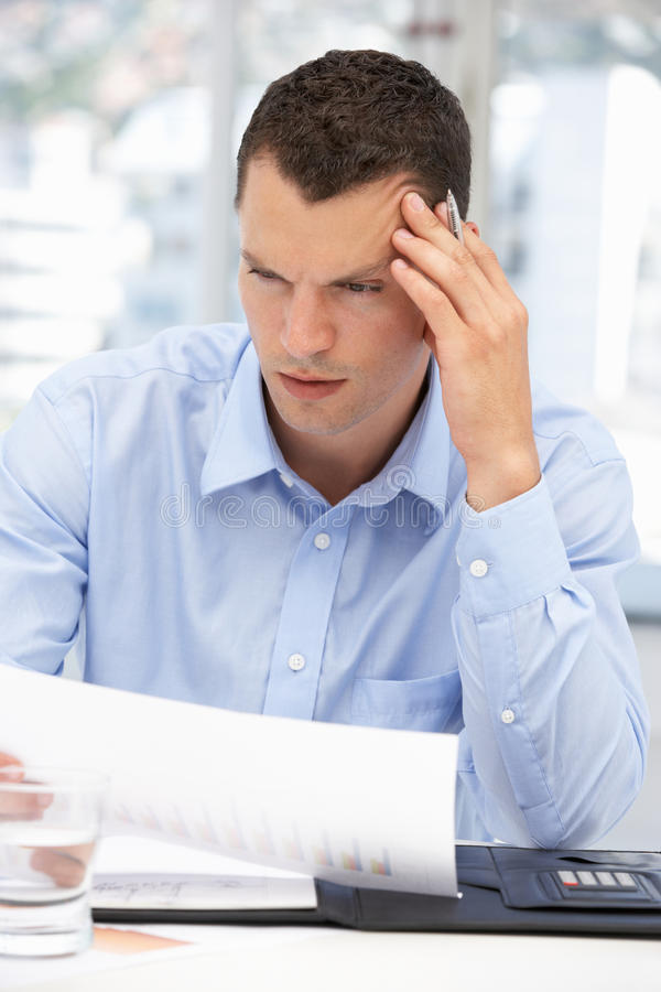 Thoughtful young businessman royalty free stock photography