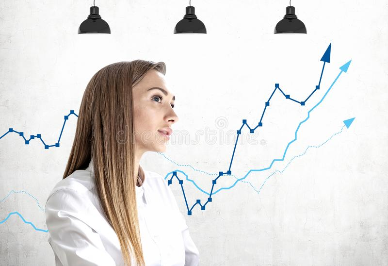 Thoughtful young businesswoman, growing graph stock images
