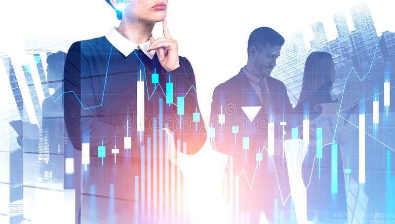 Thoughtful young businesswoman and team, graphs stock image