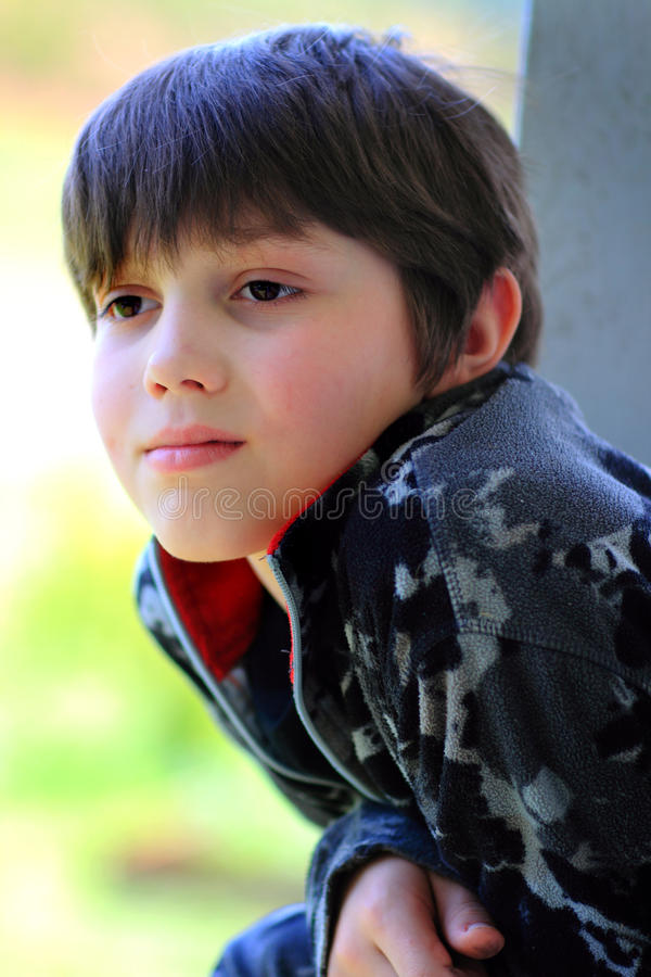 Thoughtful Young Dark Haired Boy stock photo