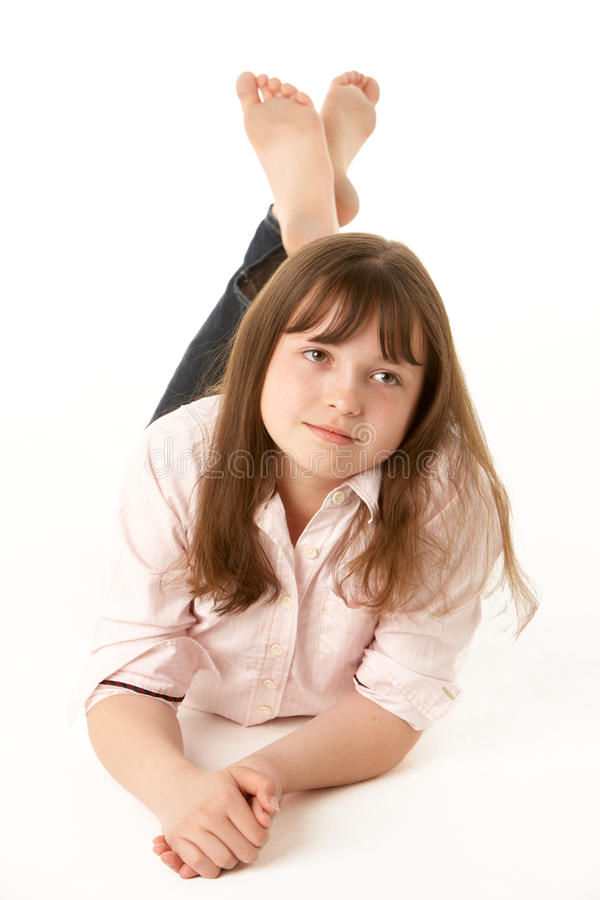 Download Thoughtful Young Girl Lying On Stomach Royalty Free Stock Photo - Image: 12988095