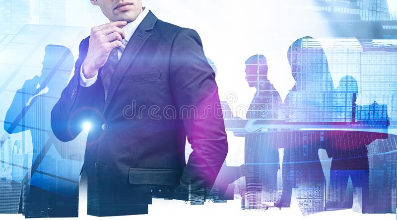 Thoughtful young manager and his team stock photos