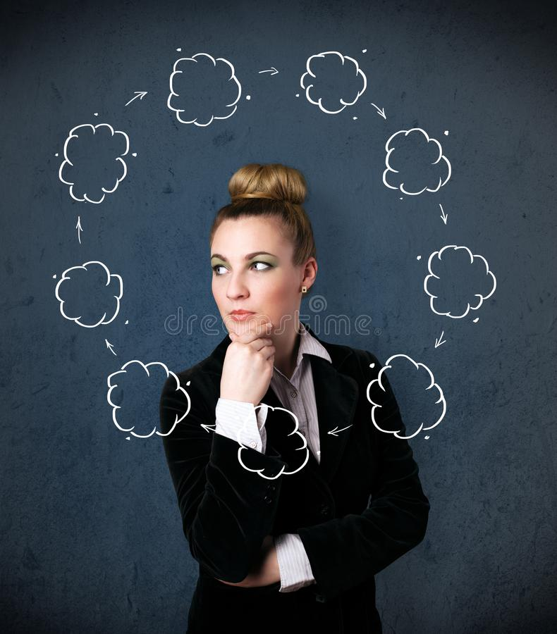 Young woman thinking with cloud circulation around her head royalty free stock image