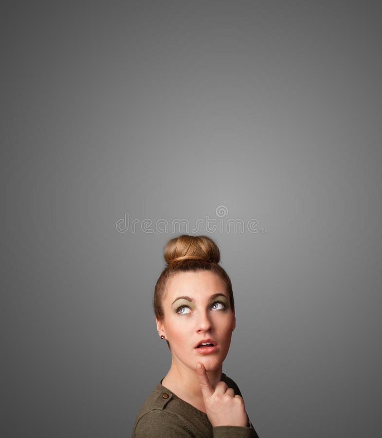 Download Thoughtful Young Woman Gesturing With Copy Space Stock Photo - Image: 32854626