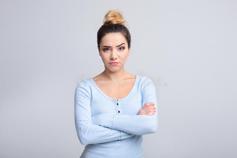 Thoughtful young woman having doubts over background royalty free stock images
