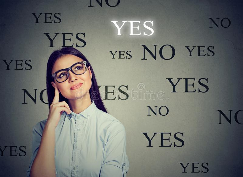 Thoughtful young woman making a YES choice royalty free stock images