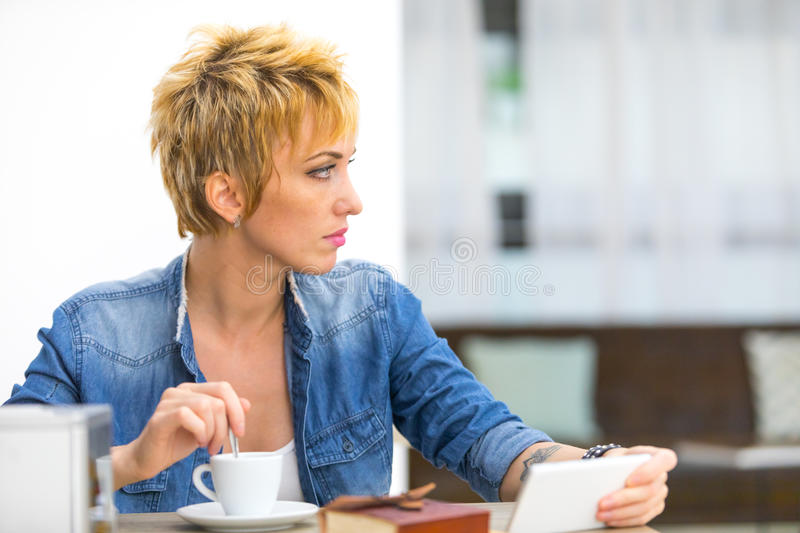 Thoughtful young woman watching something royalty free stock photo