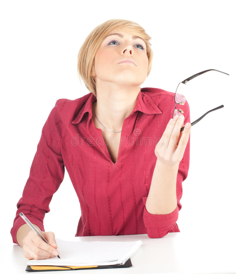 Thoughtful Young Woman Writing On Clipboard Royalty Free Stock Photos