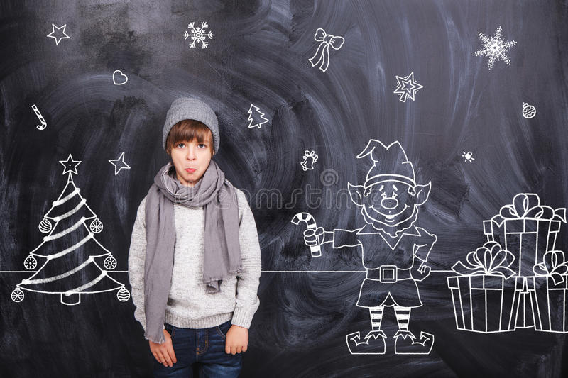 Thoughts the boy on the black chalkboards royalty free stock photography