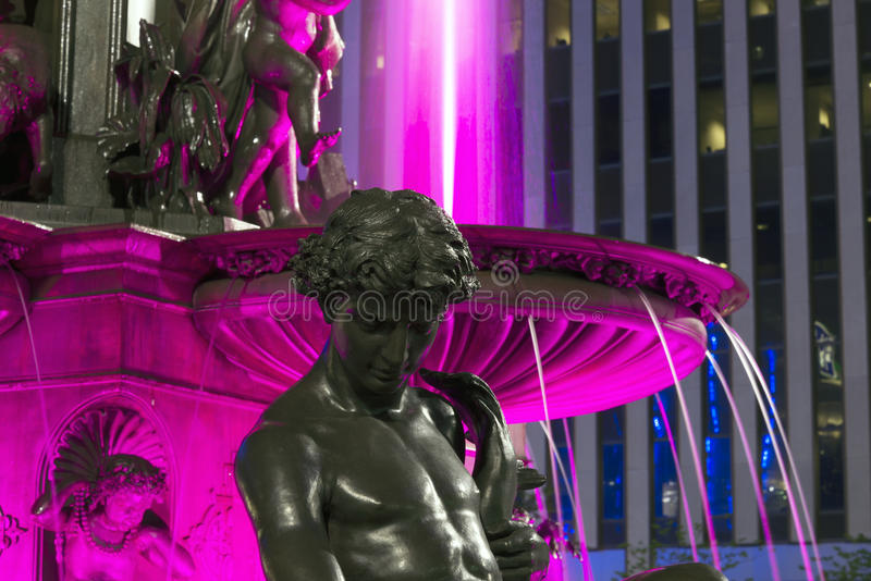 Thoughts of deep purple. Cincinnati's famous Fountain Square on a late Spring night. This is the heart of the Queen City where folks go to celebrate royalty free stock photography