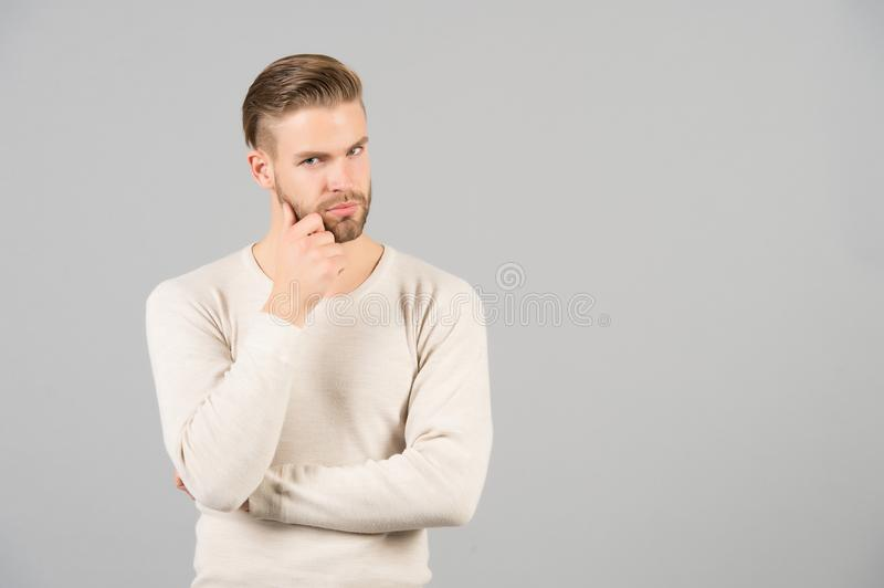 Thoughts and doubts concept. Man bearded thoughtful face, grey background. Man with beard unshaven guy looks handsome stock photos