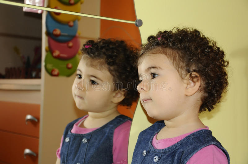 Thoughts reflections. Childish face reflected in the mirror royalty free stock photography