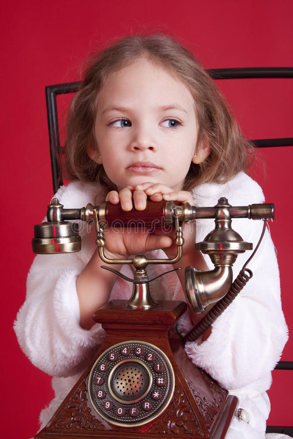 Download Thougtful Little Girl With Old Phone Stock Photo - Image: 17193600