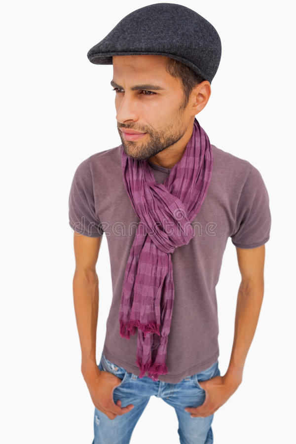 Thougthful man wearing peaked cap and scarf royalty free stock photo