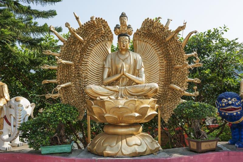 Thousand hands Buddha statue stock photos