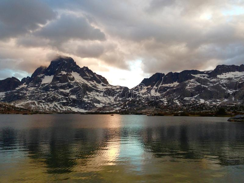 Thousand Island Sunset. A stormy sunset at Thousand Island Lake along the Pacific Crest and John Muir trails. Mt. Banner and Mt. Ritter reflect onto the lake royalty free stock images