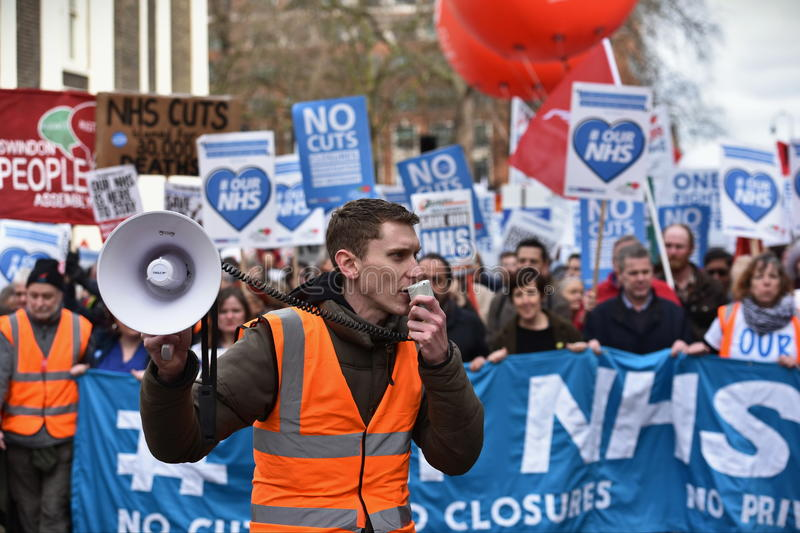Thousands March in Support of the NHS. London, UK - March 4, 2017: Protesters march through central London during a demonstration in support of the NHS royalty free stock photo