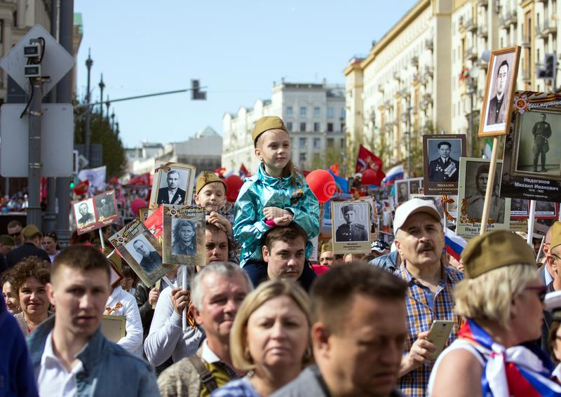 Thousands march to remember World War 2 relatives. A girl on feather`s shoulders. 2018.09.05, Moscow, Russia. Victory Day in Moscow. Immortal regiment on Moscow royalty free stock images