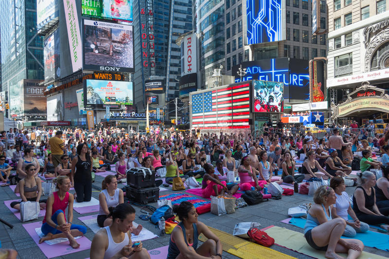 Thousands of New Yorkers practicing yoga in Times Square. royalty free stock photo