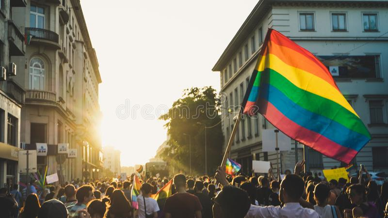 Thousands of people gathered to celebrate begining of LGBT Honor week. Participants wave rainbow flag and celebrate in the annual stock photos