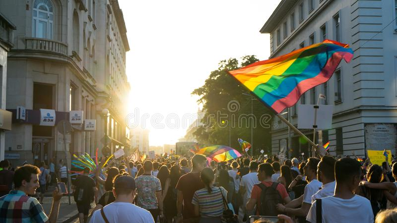 Thousands of people gathered to celebrate begining of LGBT Honor week. Participants wave rainbow flag and celebrate in the annual stock images