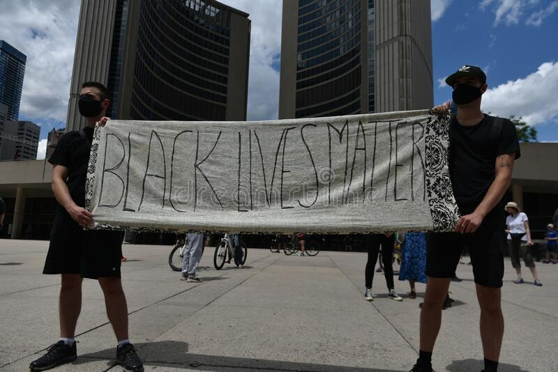 Thousands of people took to Toronto streets in separate events to protest anti-black racism stock photography