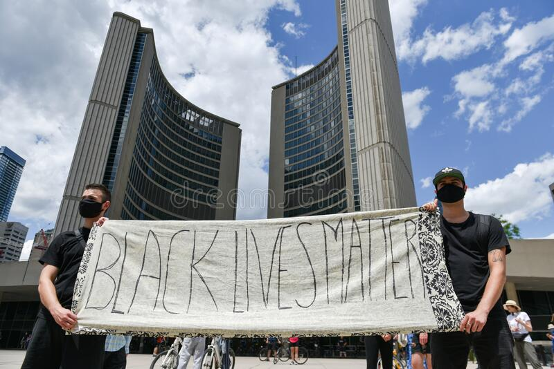 Thousands of people took to Toronto streets in separate events to protest anti-black racism stock image