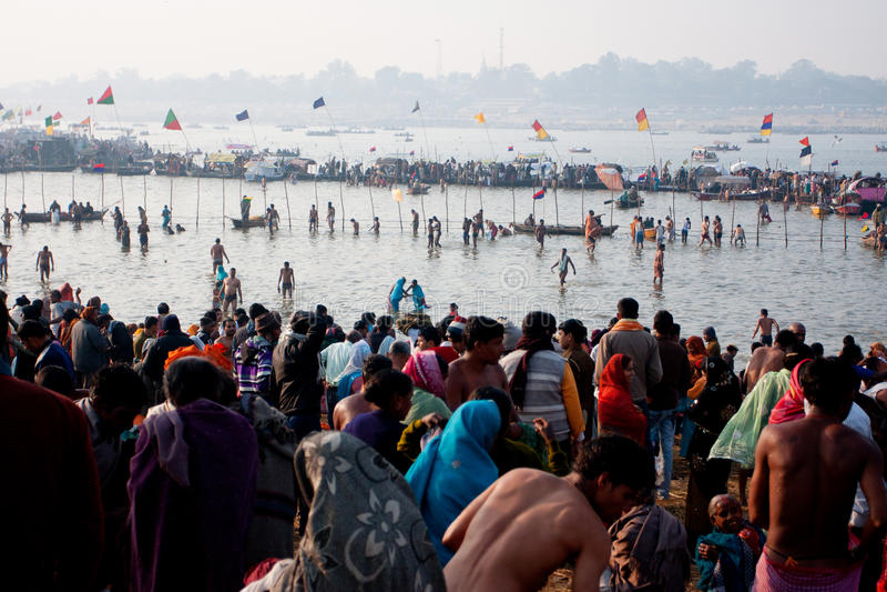Thousands of pilgrims bathing stock images