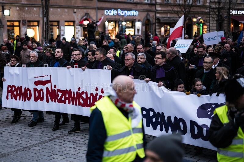 Polish judges silent rally to defend Polish justice. Marsz Tysiaca Tog. March of a thousand gowns royalty free stock photography