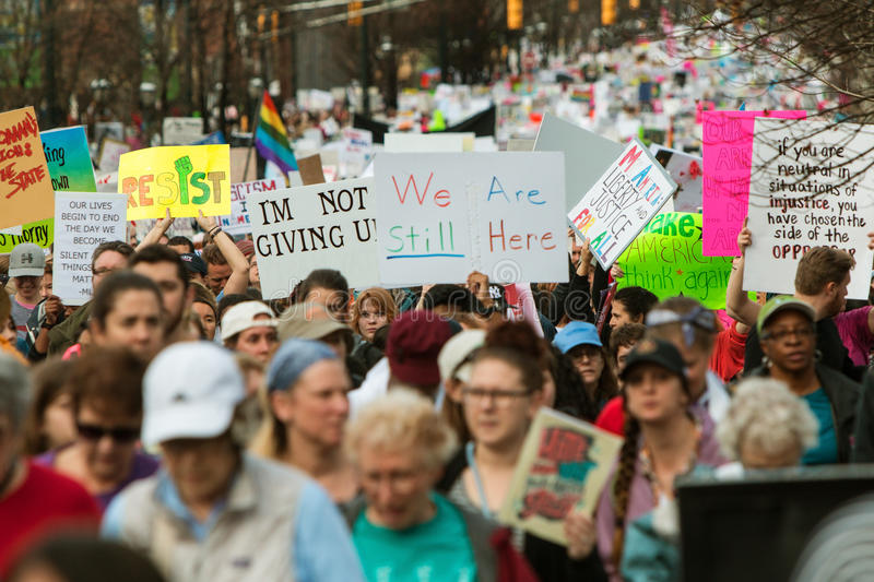 Thousands Of Protesters Pack Street In Atlanta Social Justice March. Atlanta, GA, USA - January 21, 2017: A group of protest signs rise above the crowd as stock photo