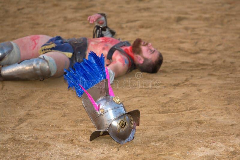 Thracian on the sand. MERIDA, SPAIN – APRIL 5: performing of gladiators fighting of Merida's Amphitheater on April 05, 2014 in Merida, Spain. Thracian and stock images