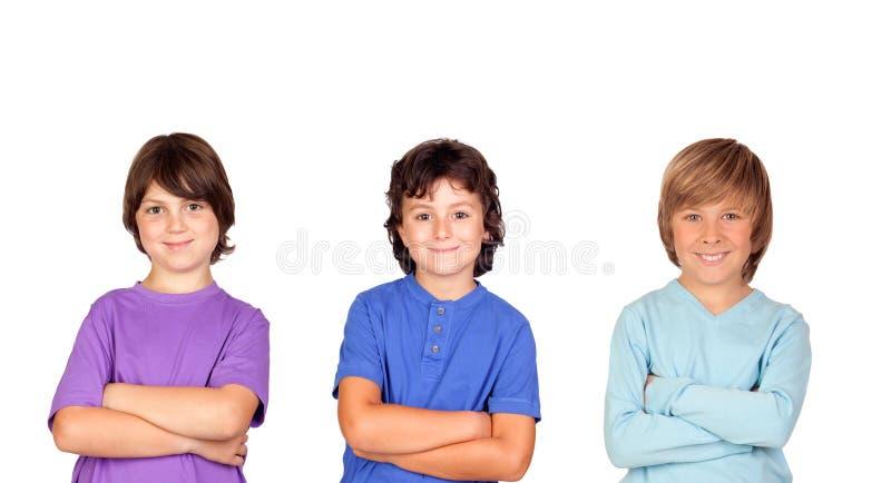 Thre kids looking at camera stock photo