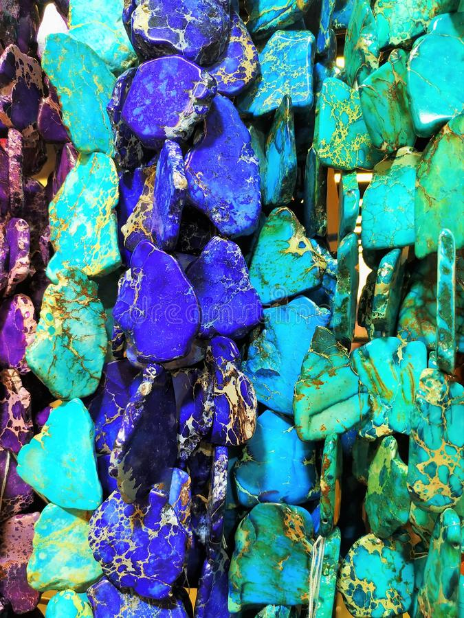 The thread of artificial stones, turquoise, malachite, for the manufacture of jewelry and decoration. royalty free stock photo