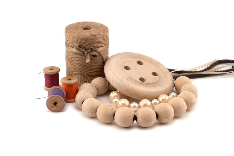 Thread beads and wooden buttons stock images