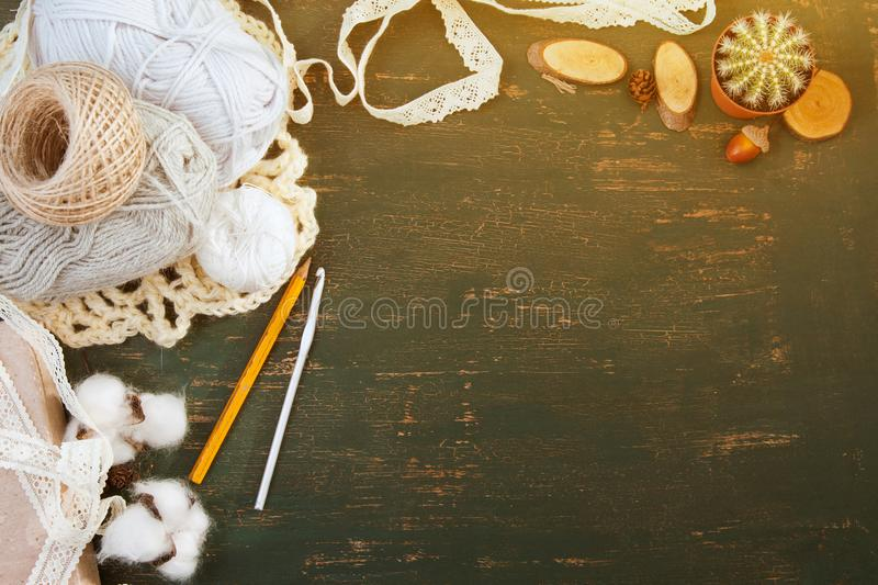 Thread for crocheting, hook, lace on a dark background. Place for text, handmade. Top view royalty free stock photography