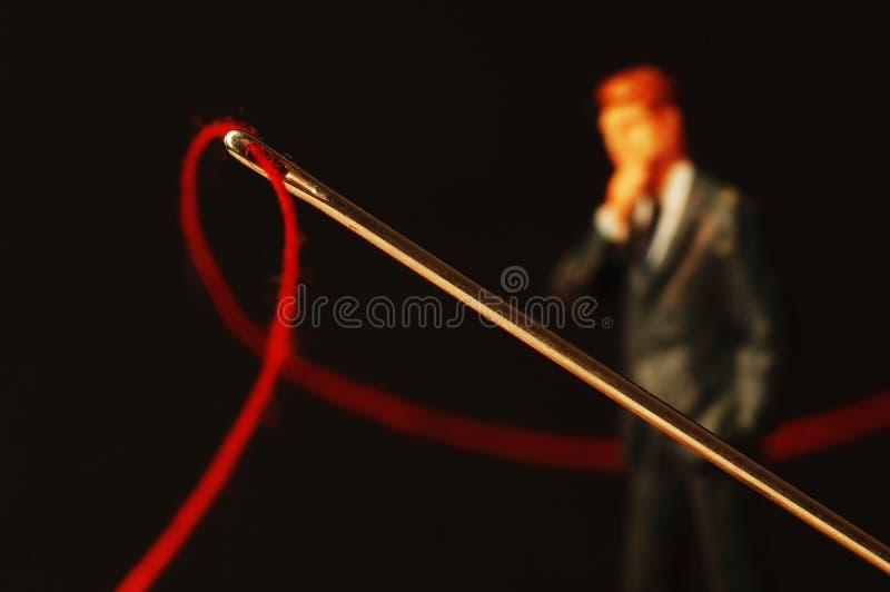 Thread Through Eye Of Needle Stock Photography