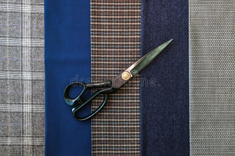 Thread fabric wool sewing man cage blue choice design atelier tailor many different things color scissors. Many different in color threads lie on the sewing royalty free stock images
