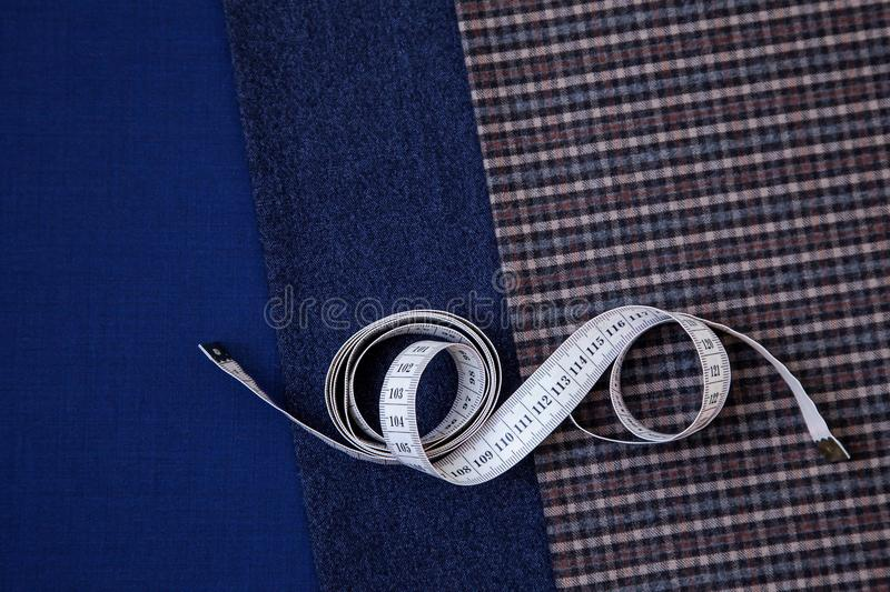 Thread fabric wool sewing man cage blue choice design atelier tailor many different things color tape-measure. Many different in color threads lie on the sewing stock photos