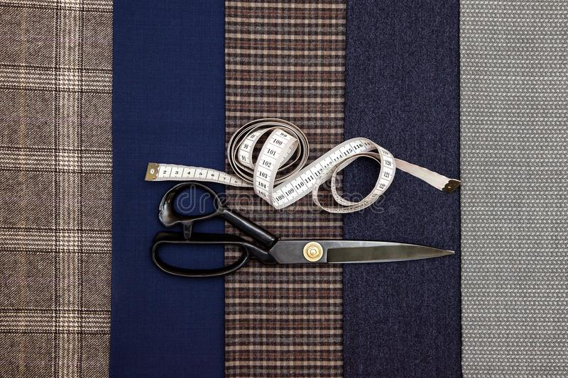 Thread fabric wool sewing man cage blue choice design atelier tailor many different things color tape-measure scissors. Many different in color threads lie on stock images