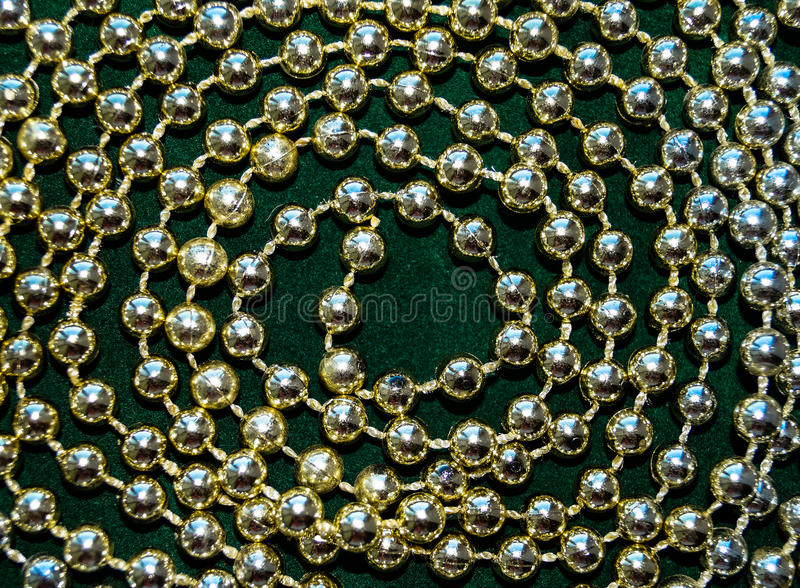 Thread of the necklace on a green background. The thread of the necklace on a green background royalty free stock photography