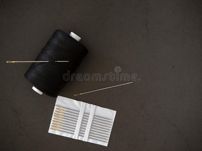 Thread needle on a black background stock photo