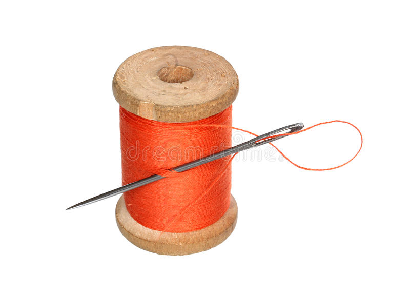 Thread roll and a needle. Roll of a thread and needle on a white background stock photo