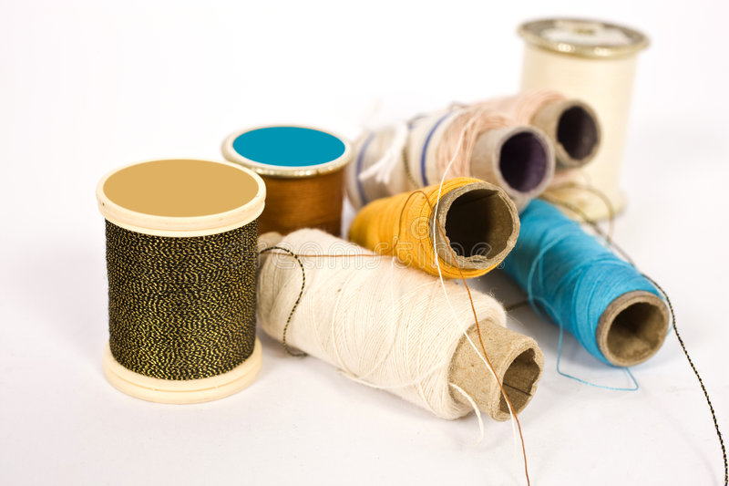Thread rolls and bobbins royalty free stock images