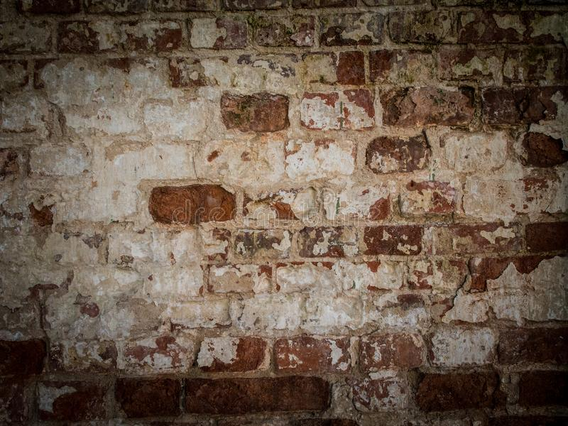 Threadbare surface of ancient masonry. Abstract background with old brick wall. royalty free stock image