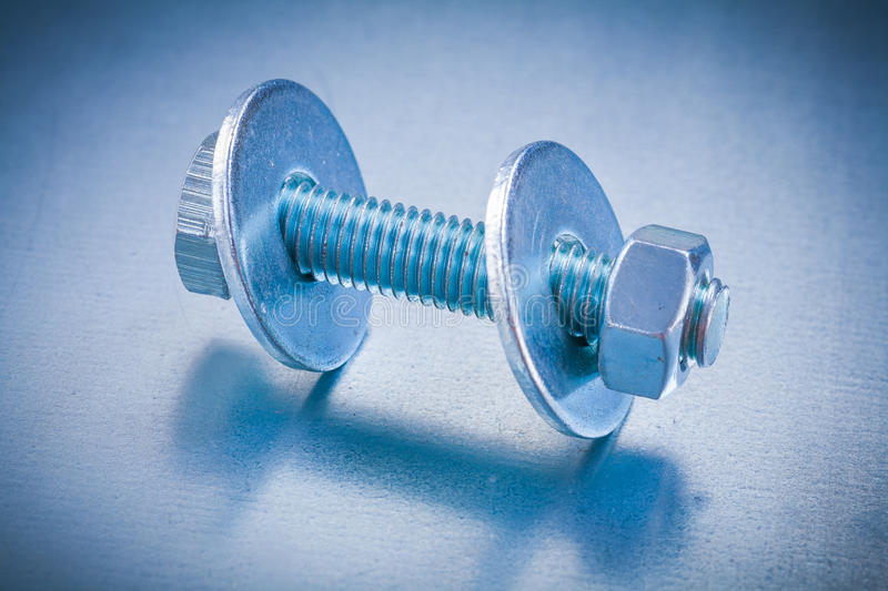 Threaded screwbolt with bolt washers and. Construction nut on metallic background repairing concept stock images