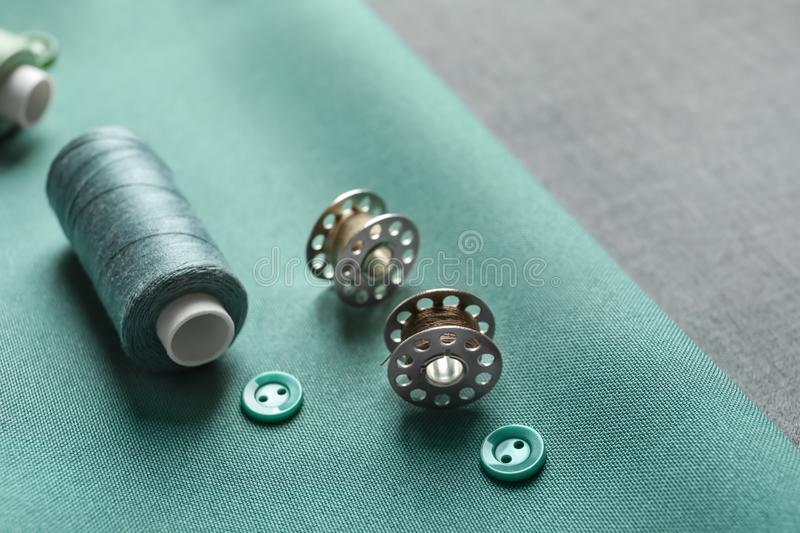 Threads, buttons and spools on fabric, royalty free stock photography