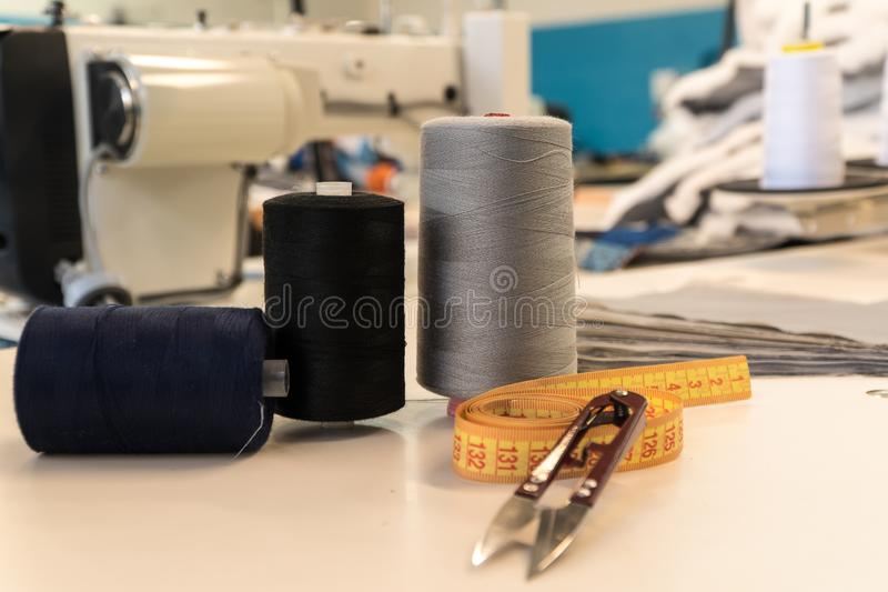 Threads centimeter scissors tool seamstresses. tailoring sewing shop royalty free stock photo