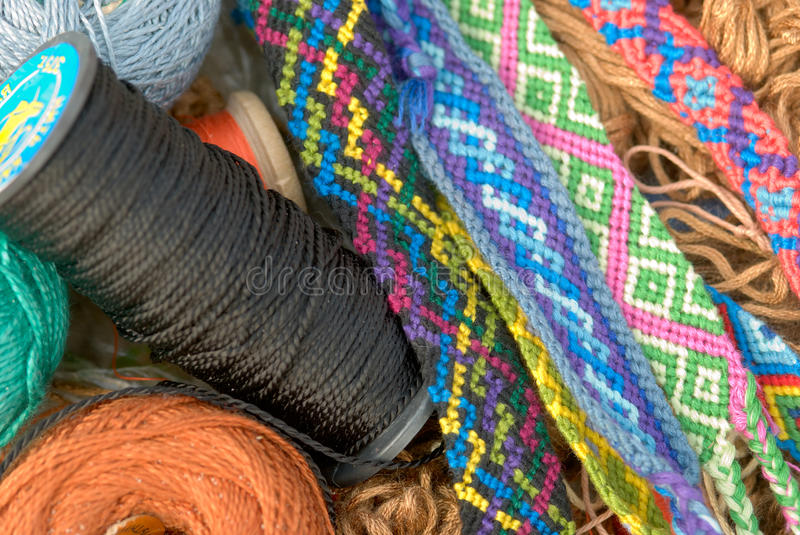 Threads and handmade bracelets stock images